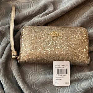 Coach glitter wallet phone wristlet champagne star